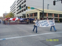 Giant flag carried by Kuna football, Veterans Day Parade.JPG
