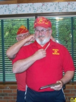 Comdt Arnie Strawn putting the medal of Marine of the year award.JPG