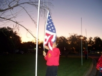 Sep19th,2009_Our Cmdt. Erickson putting up flags.JPG