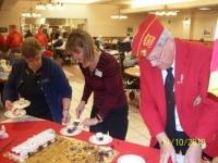Nov 10,2010_ Lisa and Art serving cake.JPG