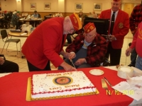 Nov10, 2010_ DetCmdt, Arnie assistancing oldest Marine cutting cake.JPG