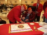 Nov10, 2010_ DetCmdt, Arnie assistancing oldest Marine cutting cake.JPG
