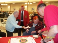 Nov10,2010_ Oldest Marine recieving first cake.JPG
