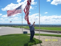 Jun11,2010_Cmdt Strawn hoisting up flag at Veterans Cemetery.JPG